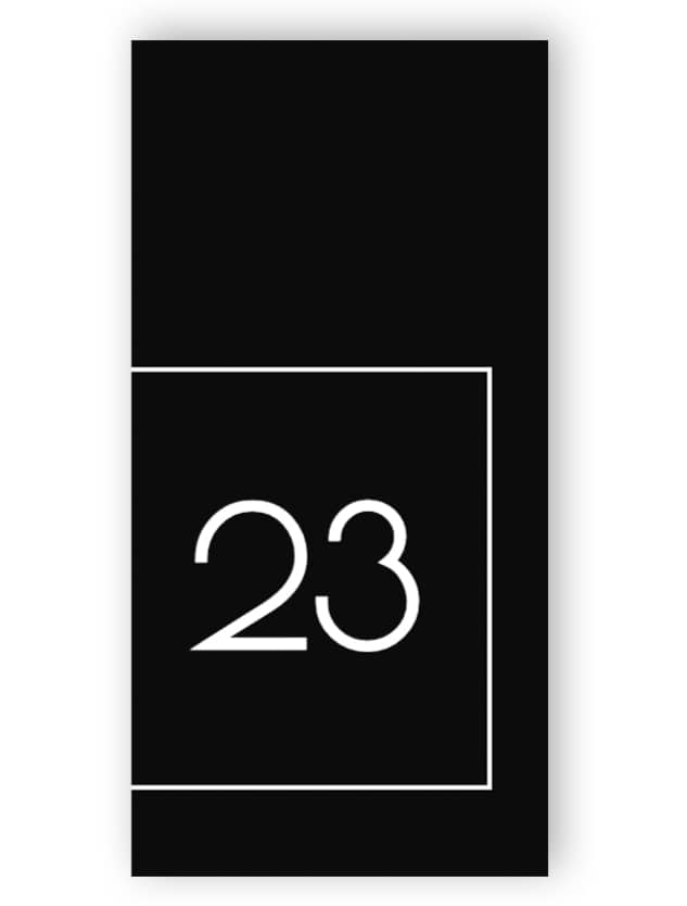Black and white rectangular door number