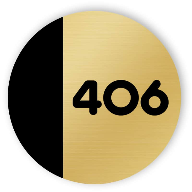 Black and gold rounded door number