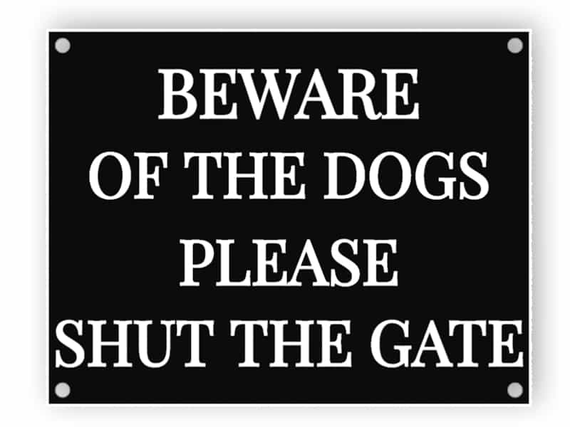 Beware of the dogs - shut the gate - black sign